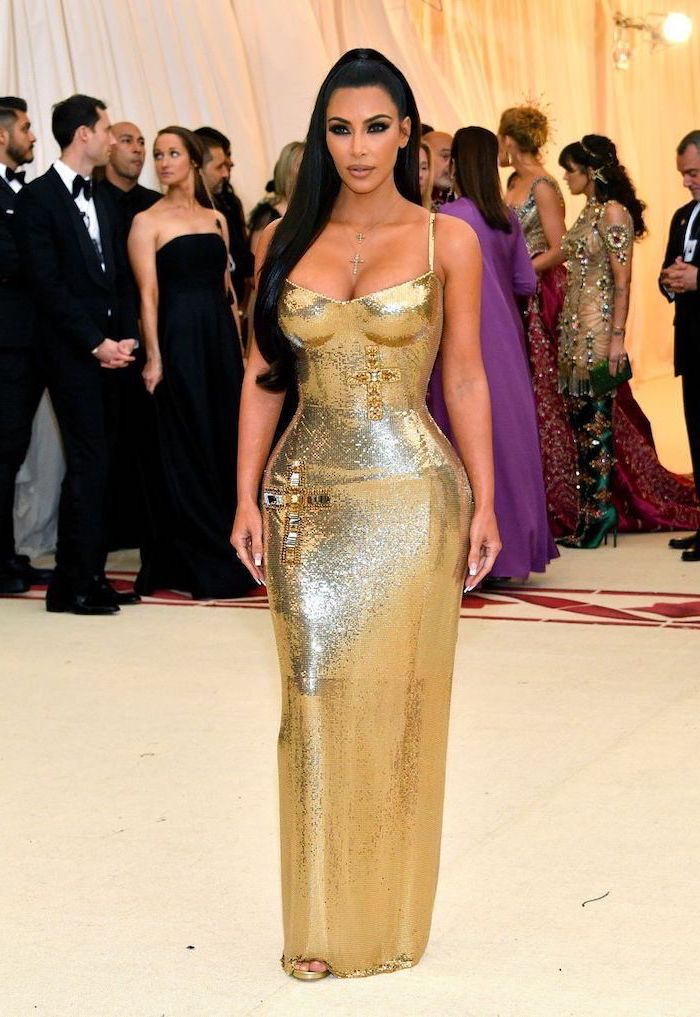 kim kardashian, met gala theme, long gold dress, crystal crosses, long black ponytail