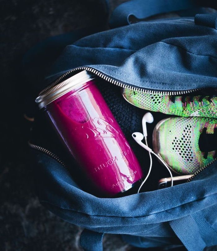 pink smoothie, in a glass bottle, sneakers and headphones in bag, protein smoothie recipes