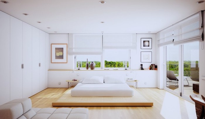 wooden bed frame, white walls, small master bedroom ideas, white sofa, tall windows