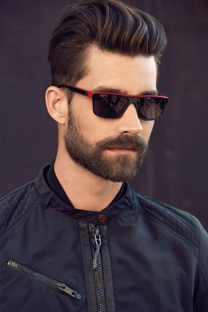 hair styles for men, man wearing sunglasses, black jacket, brown hair and beard