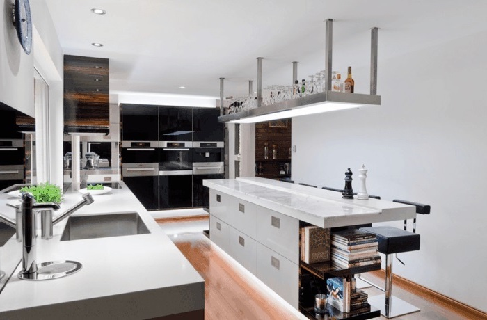 kitchen island countertop, black and white cabinets, white countertops, hanging shelf