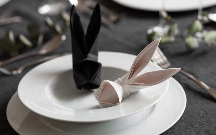bunny shaped, pink and black napkin, napkin folding with rings, white plates, black table cloth