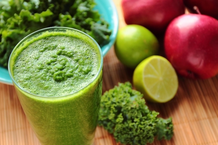 limes and apples, cabbage in a blue bowl, protein smoothie recipes, on a wooden table