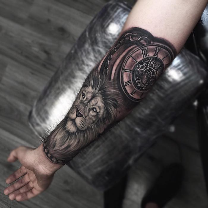 large lion head, watch with roman numerals, forearm tattoos, wooden floor