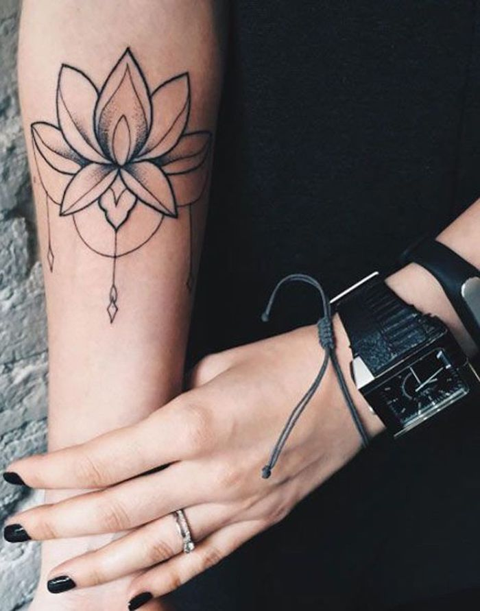 black watch and bracelets, black nail polish, feminine tattoos, lotus flower, forearm tattoo