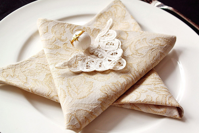 luxury wedding napkins, white lace with pearls on top, how to fold napkins, white plate