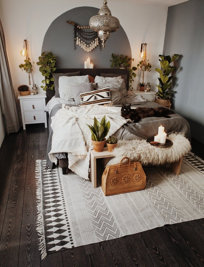 wooden floor, macrame hanging, white and grey walls, potted plants, white night stand