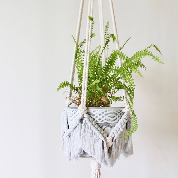 potted plant, macrame wall art, metal pot, white wall, plant hanger