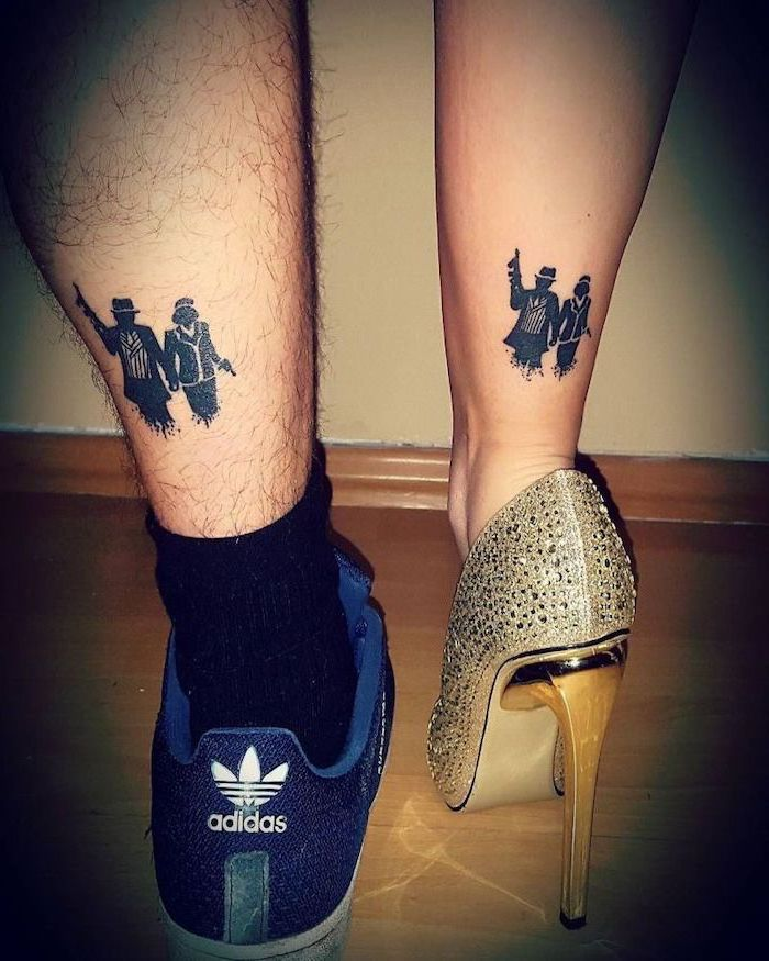 man and woman with weapons, unique couple tattoos, back of leg tattoos, gold high heels, adidas sneakers