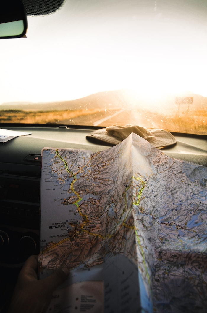unfolded map, sun setting, down a road, tumblr wallpaper, hat in a car
