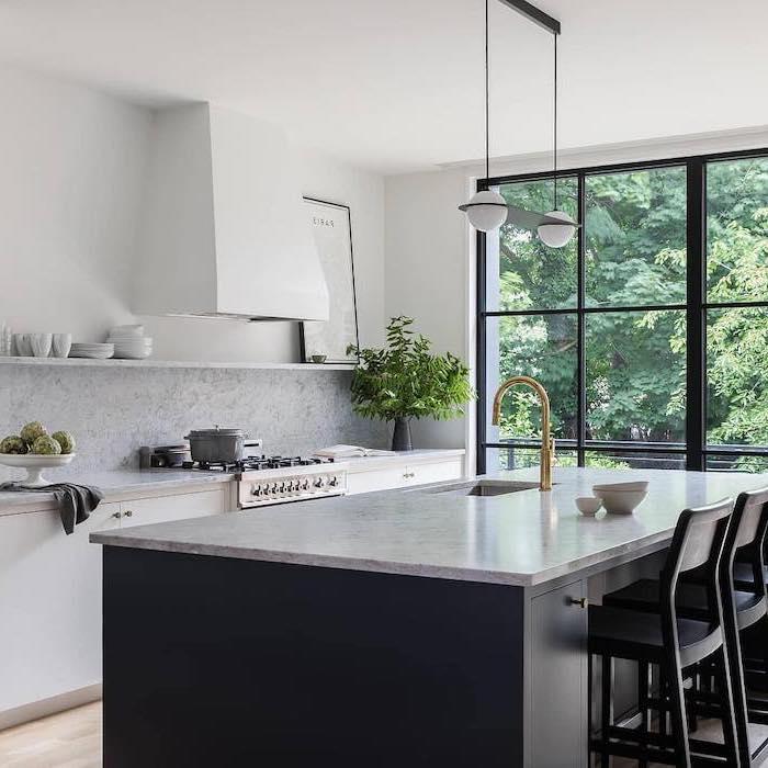 black wooden bar stools, kitchen island decor, granite countertops, grey backsplash, white cabinets