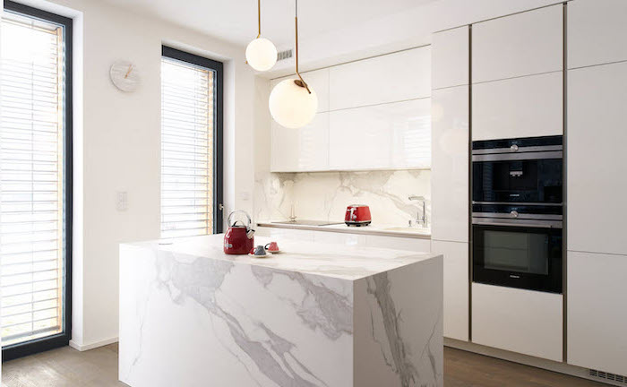 marble kitchen island, kitchen island decor, marble backsplash, white cabinets, wooden floor