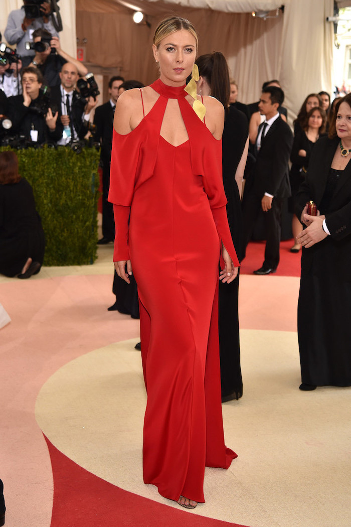 gold earrings, maria sharapova, with a long red dress, with bare shoulders, met gala theme