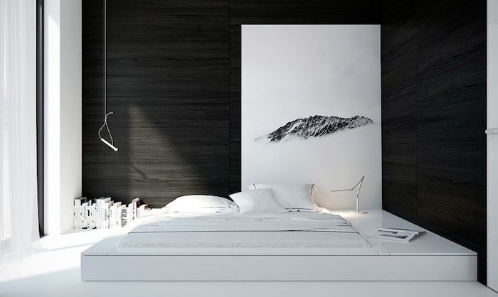 master bedrooms, black walls, white bed frame, abstract art, in black and white