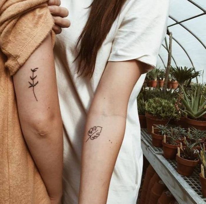 nature inspired, unique couple tattoos, potted plants, white shirt, brown blouse