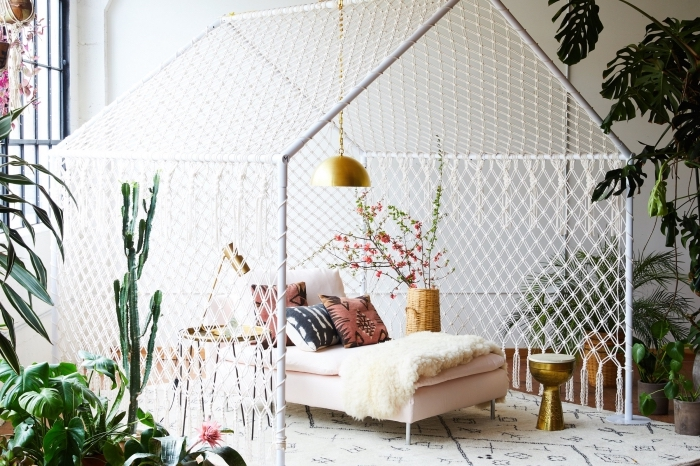 large tent, made of macrame, light pink bed, how to do macrame, potted plants, colourful throw pillows