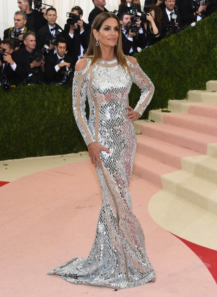 cindy crawford, long silver metallic dress, with long sleeves, met gala fashion, long brown hair