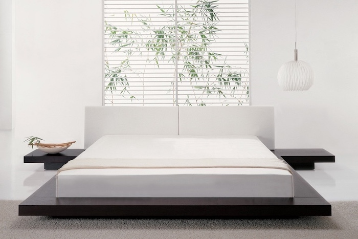 white blinds, over the bed decor, black wooden bed frame, white leather headboard, white walls