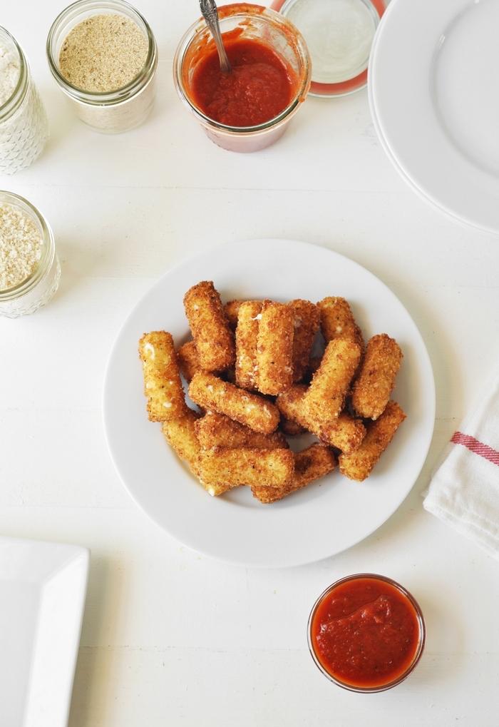 mozzarella sticks, on white plates, vegan appetizers, marinara sauce, in glass bowls,
