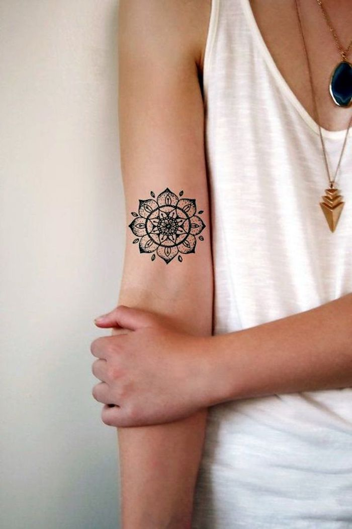 white top, leg tattoos for girls, mandala inside arm tattoo, white background, gold necklaces
