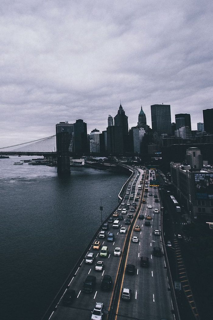 cars going down a highway, next to the ocean, new york city landscape, tumblr desktop backgrounds, grey sky