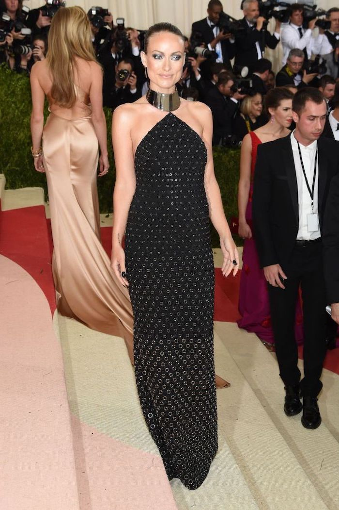 costume institute, long black dress, with metal rings, olivia wilde, with slicked back hair