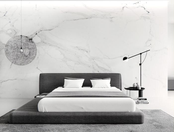master bedroom ideas, marble wall, dark grey bed, grey carpet, black metal night stand