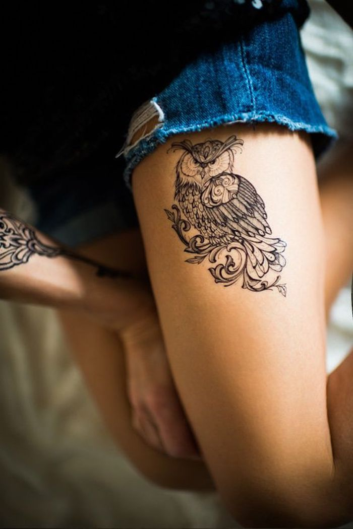 owl thigh tattoo, leg tattoos for girls, denim shorts, black shirt