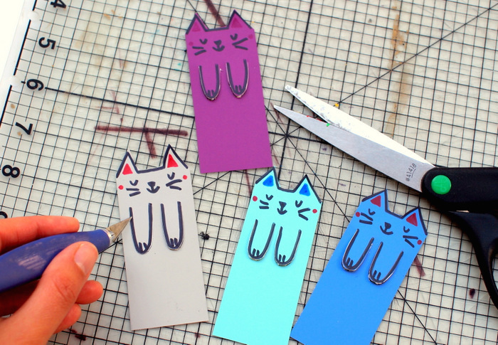 pre k learning games, colourful paper, cat faces and paws drawn on it, large ruler