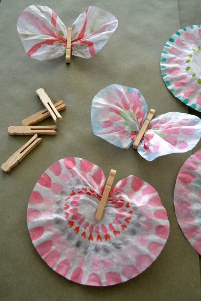 colourful butterflies, made of paper, and clothespins, indoor group games for kids