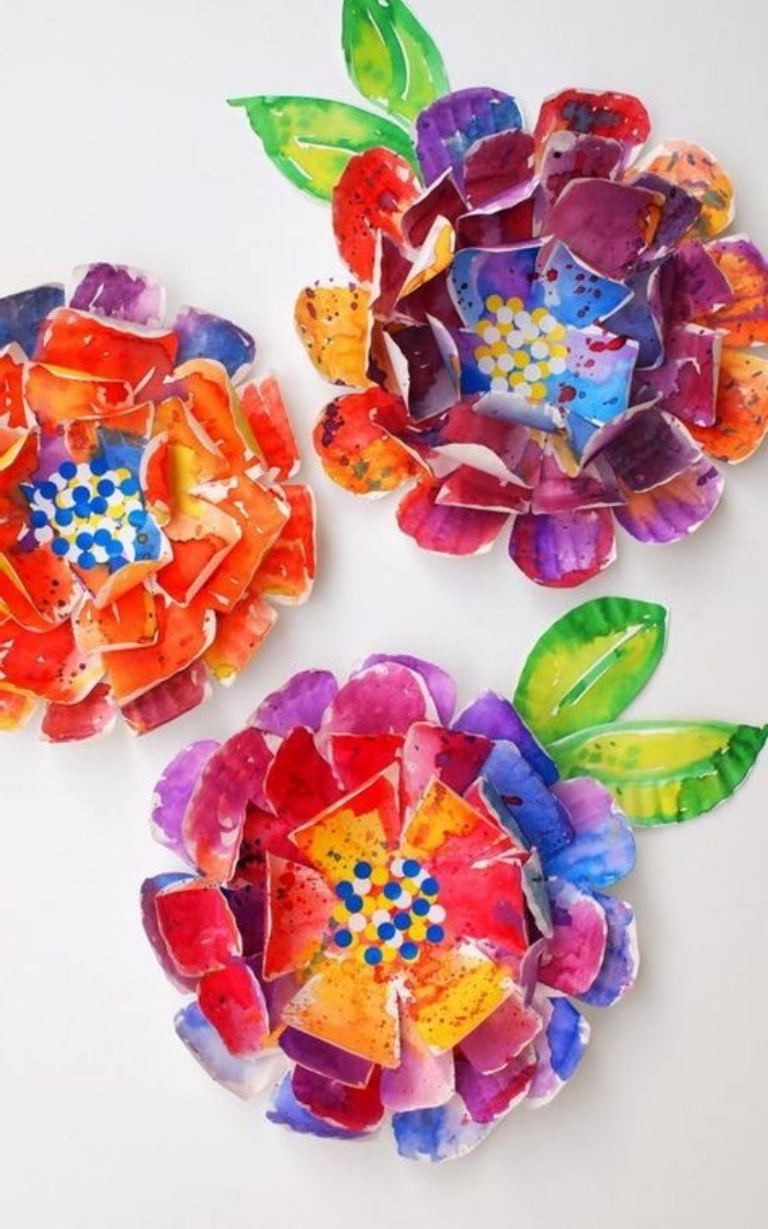 colourful flowers, made out of paper, preschool activities, with green leaves, on white backround