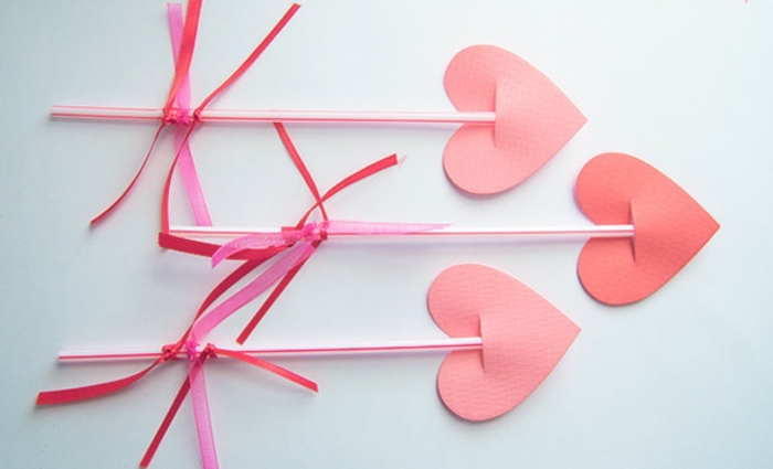 indoor group games for kids, paper hearts, with plastic straws, white background