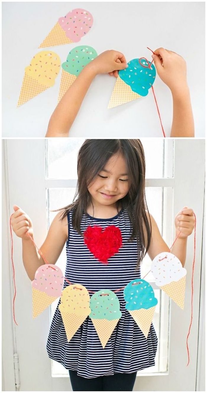 paper ice cream cones, indoor group games for kids, girl holding them, on a piece of strand