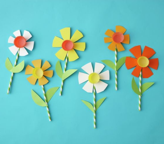 paper straws, paper flowers, on blue background, kindergarten classroom games