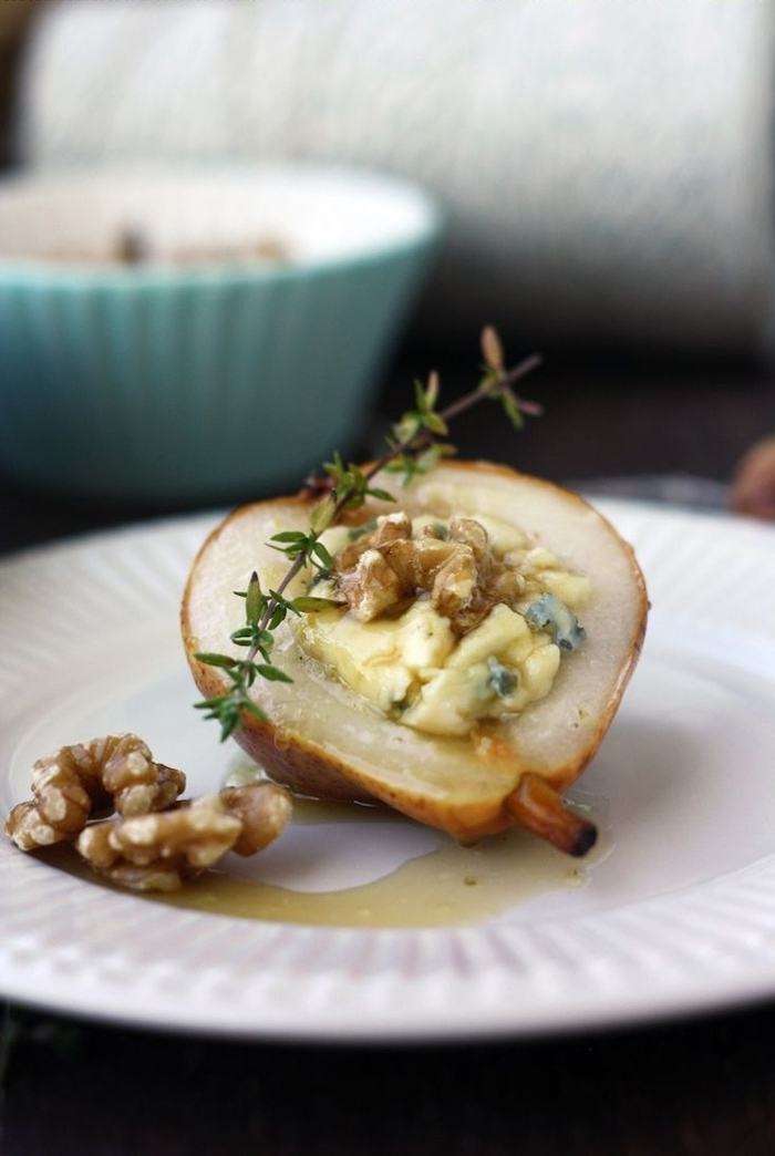 baked pear, filled with nuts and melted cheese, easy vegetarian appetizers, in a white plate