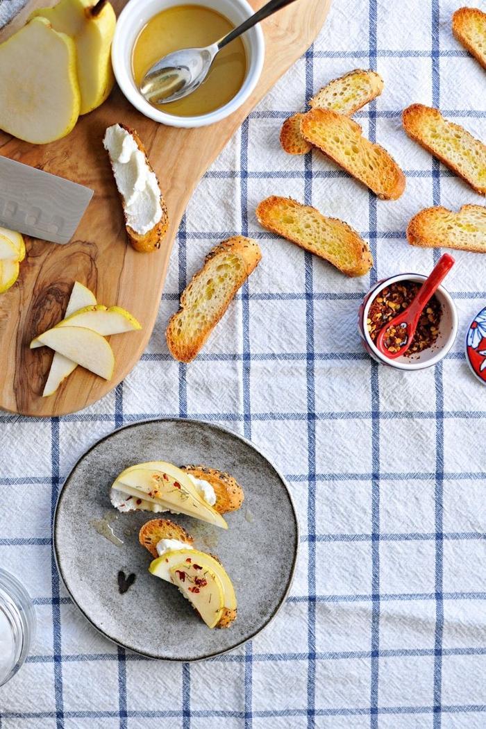 baked slice of bruschetta, pears on top, with honey, vegan superbowl snacks