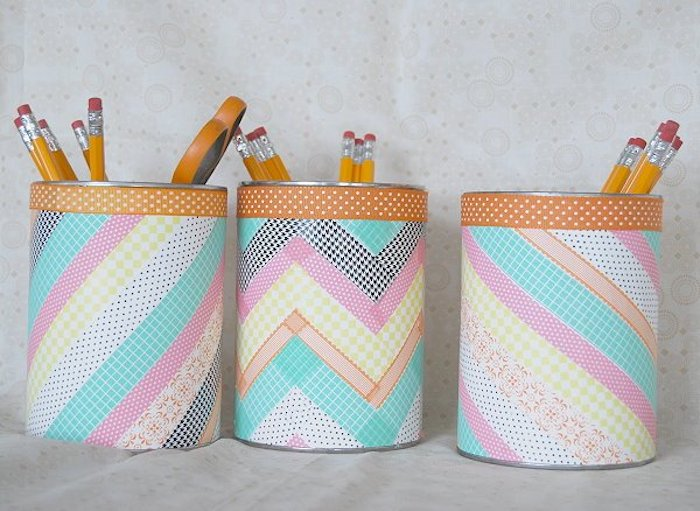 colourful washi tape, taped over tin cans, used as pencil holders, preschool learning