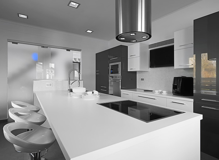 white bar stools, grey and white cabinets, kitchen island decor, white countertops