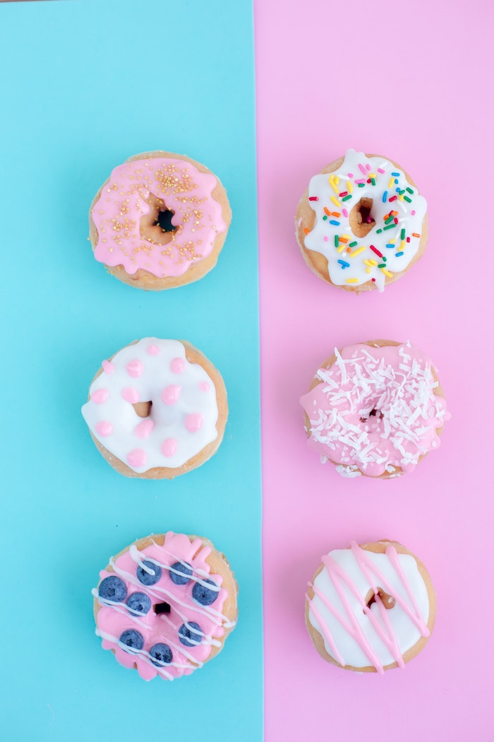 blue and pink background, black on white tumblr, six donuts, with different icing