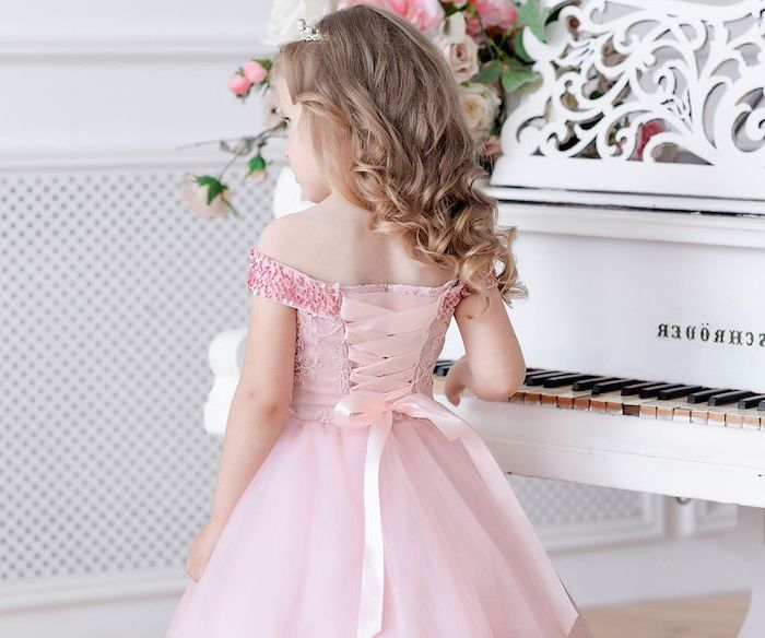 pink tulle dress, with sequins and ribbon, white piano, blonde wavy hair, lace flower girl dresses