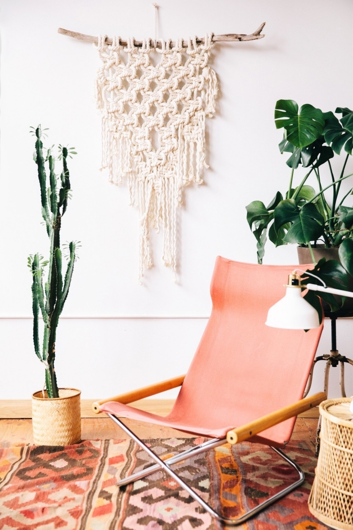 light pink chair, potted cactus, how to do macrame, white wall, printed rug