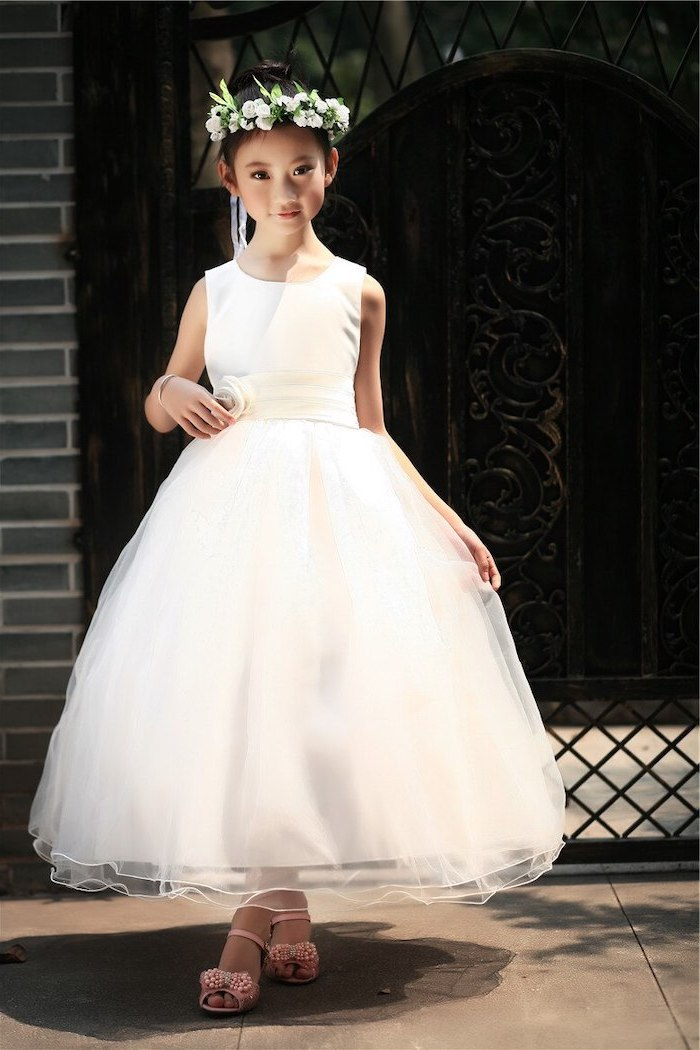cute dresses for girls, white tulle dress, white flower crown black hair, in a bun, pink sandals