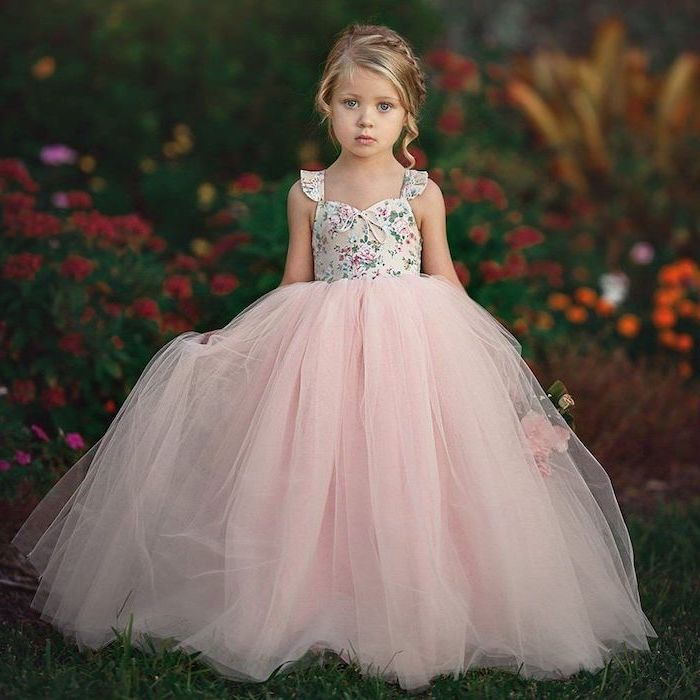floral top, pink tulle bottom, blonde braided hair, flowers in the background, cute dresses for girls