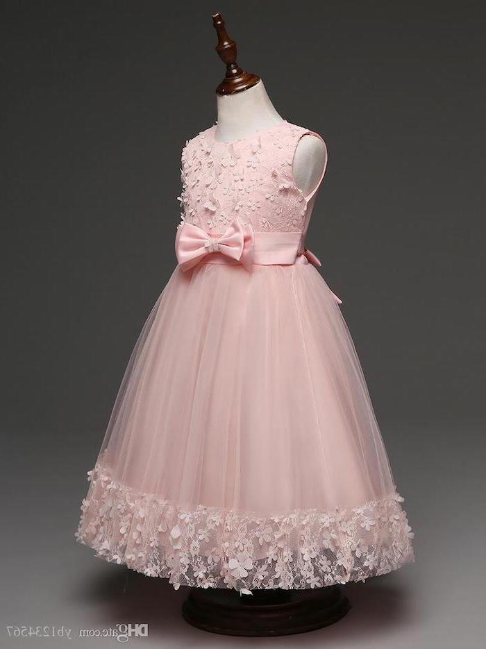 pink lace and tulle dress, with a pink bow, dressed on a mannequin, cute dresses for girls, grey background