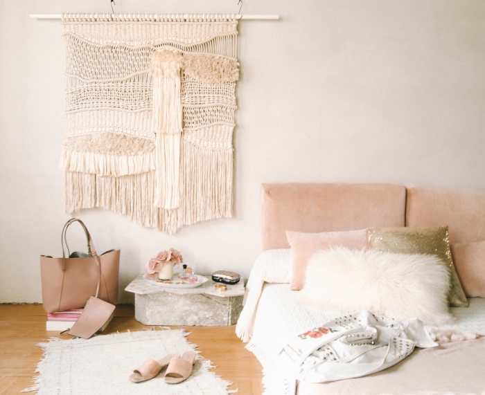 light pink velvet sofa, white wall, white rug, how to do macrame, wooden floor, nude bag and sandals