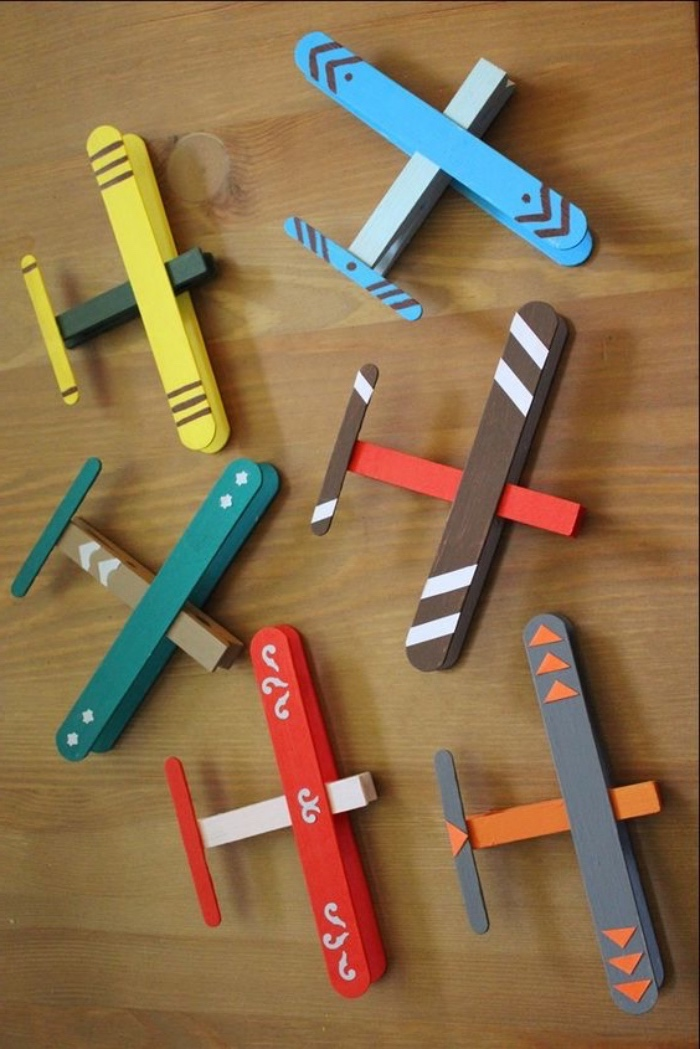 colourful aiplanes, made of popsicle wooden sticks, pre k learning games, wooden table
