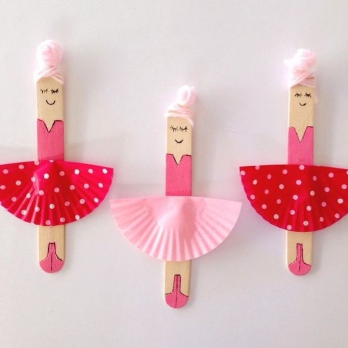 ballerinas made of popsicle sticks, fun indoor games for kids, pleated paper for skirts, pink strands for hair