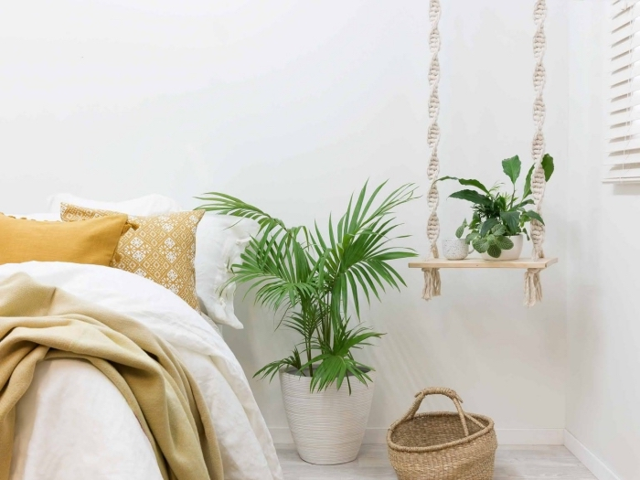 plant hanger, white wall, how to make macrame, potted plants, wooden basket, yellow throw pillows
