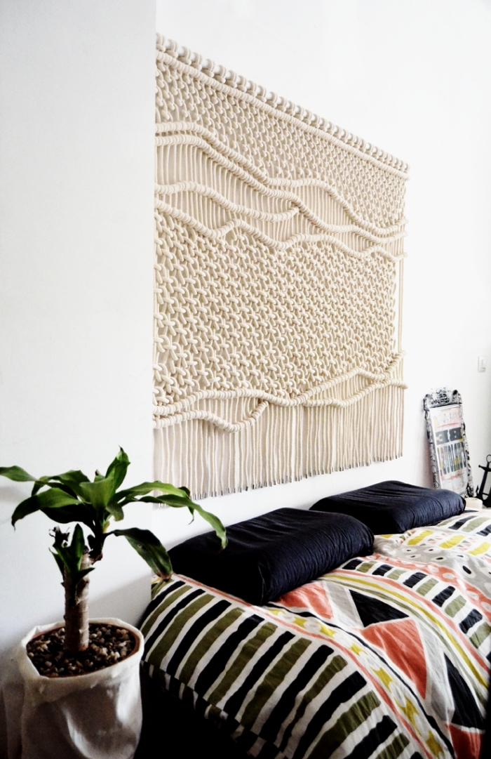 macrame for beginners, black pillows, colourful blanket, white walls, potted plants