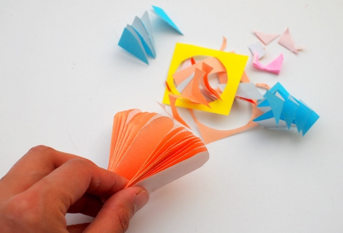 cut up paper, prek learning games, orange pleated paper, step by step, diy tutorial
